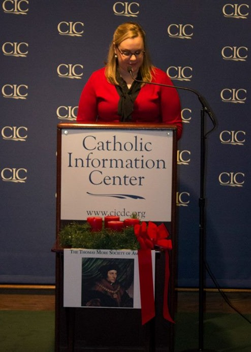 Mary Powers speaks at the Christmas Poetry Reading.